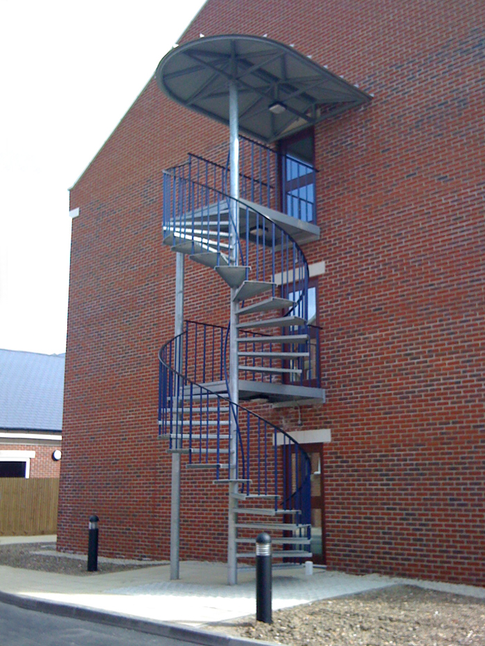 Galvanised spiral staircase with canopy to a new accommodation block in Portsmouth.