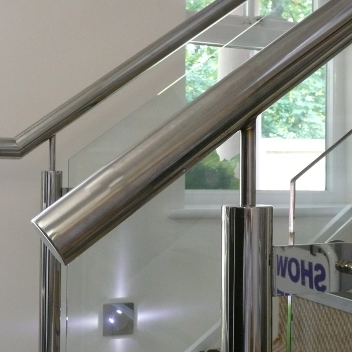 stainless steel balustrading with glass infills to new staircase in new contemporary flats in Dorset.