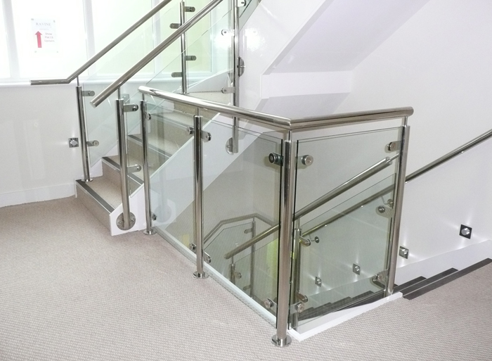Mild steel staircase, stainless steel balustrade with glass infills for a leading options in UK.