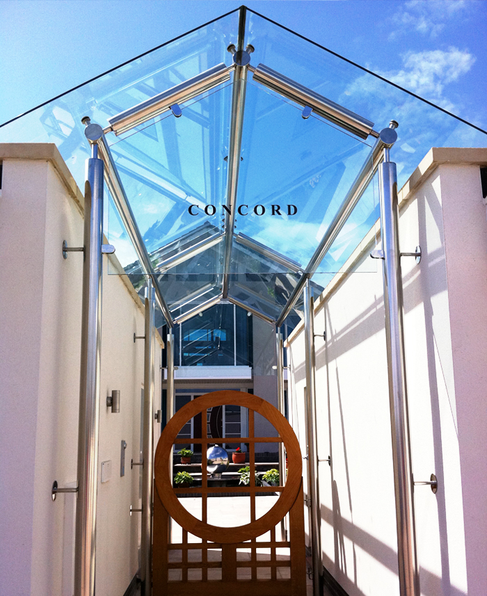 Stainless steel glass structure/ canopy / entrance for new contemporary sea front dwelling.