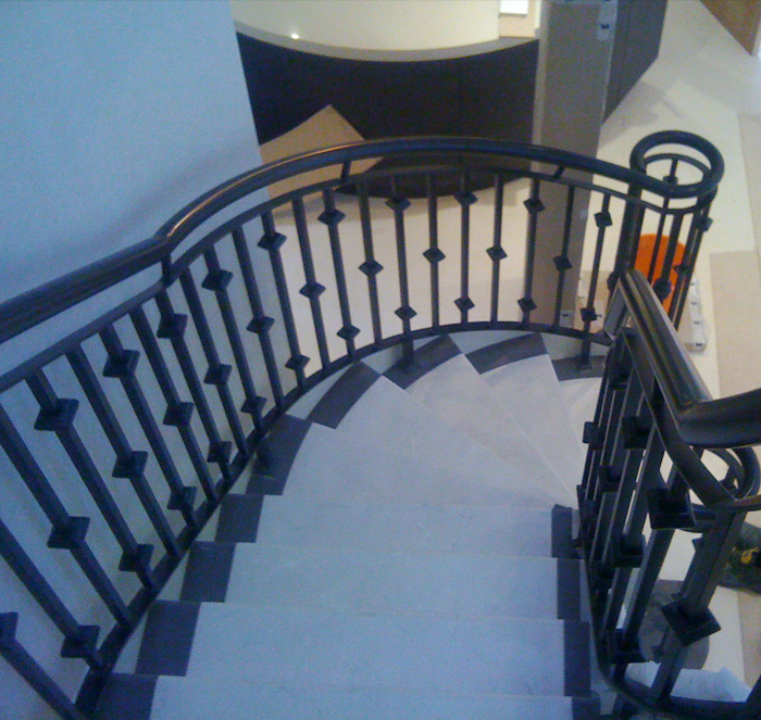 Powdercoated architectural balustrading to new mild steel helicore staircase in Sandbanks, Poole