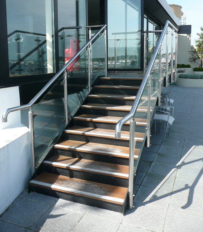 Mild steel staircase with stainless steel balustrade and glass infill's to a restaurant in Sandbanks, Poole