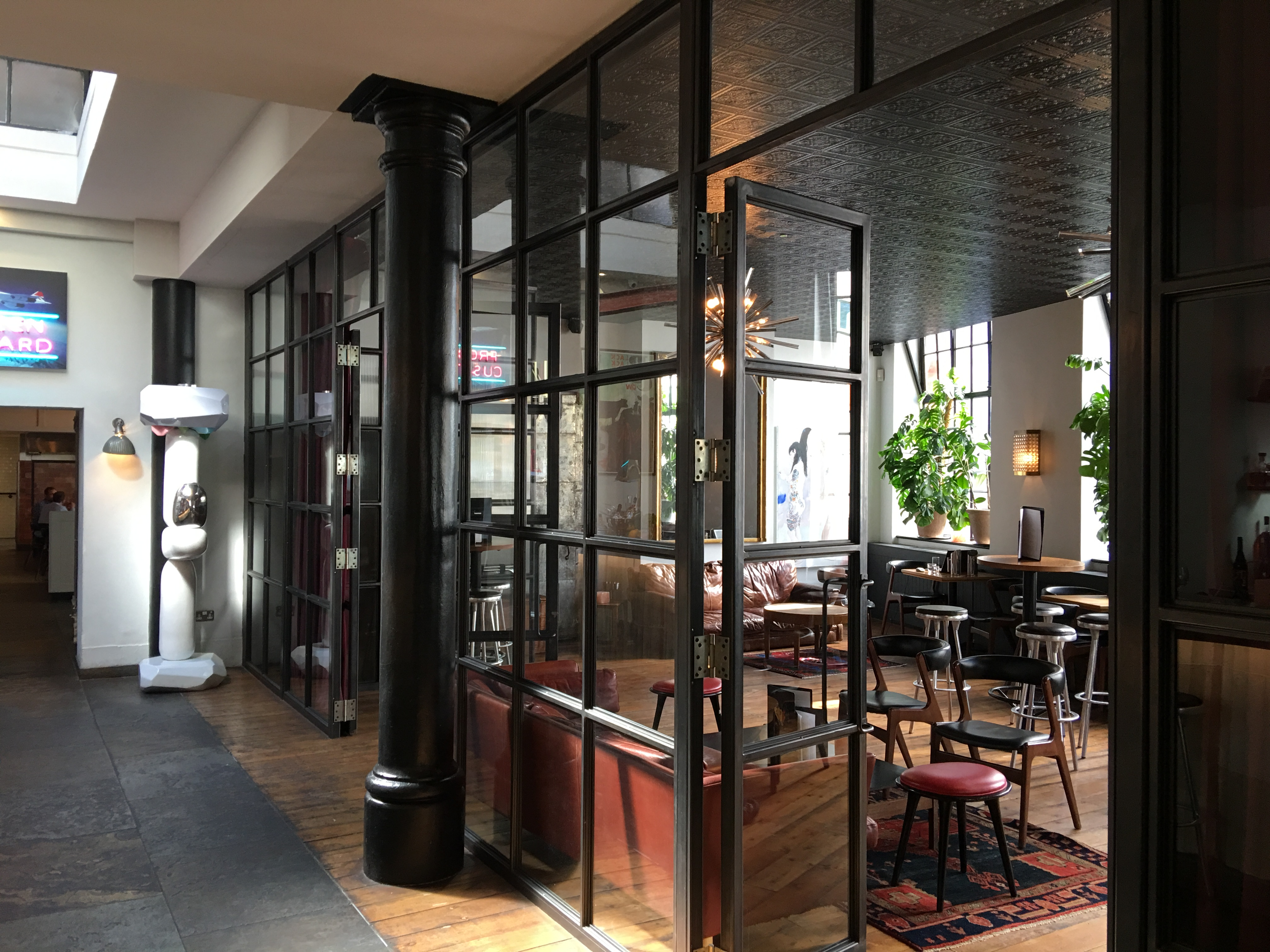 Blackened steel glazed screens and doors to another leading restaurant in London.